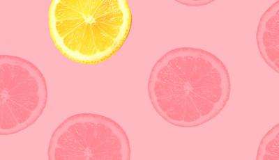 Zitrone auf rosa Hintergrund